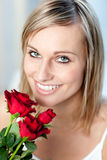 Portrait of a smiling woman holding roses Stock Photos