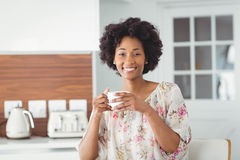 Portrait of smiling woman holding white cup Royalty Free Stock Images