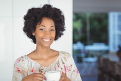 Portrait of smiling woman holding white cup Royalty Free Stock Photos