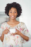 Portrait of smiling woman holding white cup Stock Images