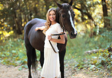 Portrait smiling woman and horse Stock Photos