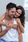 Portrait of smiling woman hugging man Royalty Free Stock Photography