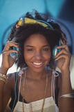 Portrait of smiling woman listening music Stock Image