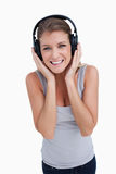 Portrait of a smiling woman listening to music Royalty Free Stock Photo