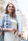 Portrait of smiling woman with long hair wearing casual clothes Royalty Free Stock Photos