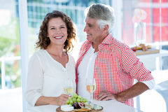 Portrait of smiling woman with man at restaurant Royalty Free Stock Photography
