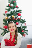 Portrait of smiling woman near Christmas tree Stock Photography