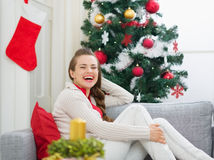 Portrait of smiling woman near Christmas tree Royalty Free Stock Images