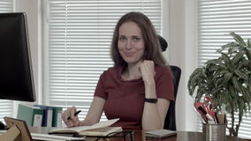 Portrait smiling woman at the office working dolly in stock footage