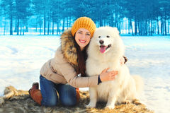Portrait smiling woman owner and white Samoyed dog in winter Royalty Free Stock Photos