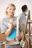Portrait of smiling woman painting Royalty Free Stock Image