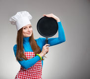 Portrait of a smiling woman with the pan stock image