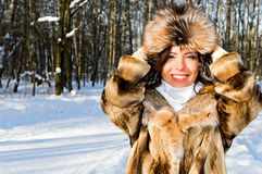 Portrait of smiling woman in park royalty free stock photo