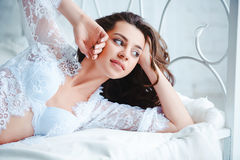 Portrait of smiling woman with perfect smile and beautiful face waking up in the morning. Beauty female wearing lingerie Royalty Free Stock Photo