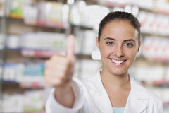 Portrait of Smiling Woman Pharmacist in Pharmacy Stock Photos