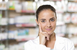 Portrait of Smiling Woman Pharmacist in Pharmacy Royalty Free Stock Photos