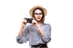 Portrait of smiling woman with photo camera looking at camera isolated on white. Background Royalty Free Stock Image