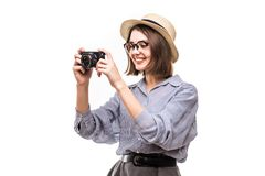 Portrait of smiling woman with photo camera looking at camera isolated on white. Background Stock Images