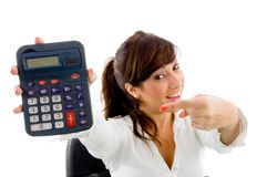 Portrait of smiling woman pointing at calculator royalty free stock photos