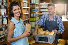Portrait of smiling woman purchasing bread at bakery store. In supermarket Royalty Free Stock Images