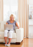 Portrait of smiling woman purchasing online Stock Photos