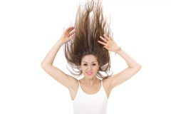 Portrait of smiling woman with raised hair up on white background. crazy girl Stock Photography