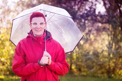Portrait of woman in red raincoat and umbrella. Portrait of smiling woman in red raincoat and umbrella Royalty Free Stock Images