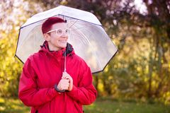 Portrait of woman in red raincoat and umbrella. Portrait of smiling woman in red raincoat and umbrella Stock Photography