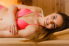 Portrait of smiling woman relaxing in sauna. Spa wellbeing Stock Photo