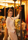 Portrait of smiling woman riding on carousel Stock Photos