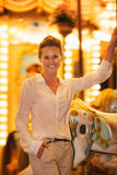 Portrait of smiling woman riding on carousel Stock Photo