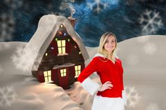 Portrait of smiling woman in santa costume Royalty Free Stock Photo