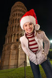 Portrait of smiling woman in Santa hat near Leaning Tower, Pisa Stock Photos