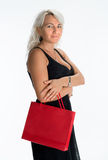 Portrait of  smiling woman with shopping bag Royalty Free Stock Image