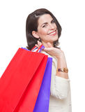 Portrait of  smiling woman with shopping bags. Royalty Free Stock Photos