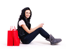 Portrait of smiling woman with shopping bags. Stock Photography