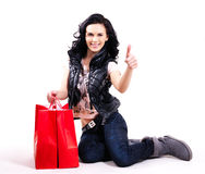 Portrait of smiling woman with shopping bags. Royalty Free Stock Image