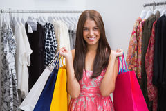Portrait of smiling woman with shopping bags looking at camera Stock Photo