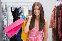 Portrait of smiling woman with shopping bags looking at camera Stock Image