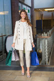 Portrait of smiling woman with shopping bags looking at camera Royalty Free Stock Images