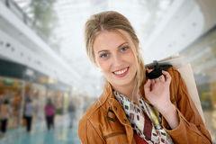 Portrait of smiling woman in shopping center Stock Photo