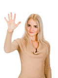 Portrait of smiling woman showing five fingers Stock Images