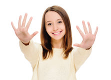 Portrait of smiling woman showing ten fingers Royalty Free Stock Image