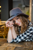 Portrait of smiling woman sitting at table Royalty Free Stock Image