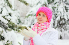 Portrait smiling woman in snowy winter day near christmas tree Royalty Free Stock Images