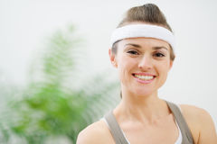 Portrait of smiling woman in sportswear Stock Images