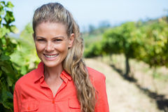 Portrait of smiling woman standing in vineyard Stock Image