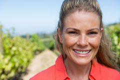 Portrait of smiling woman standing in vineyard Royalty Free Stock Photo