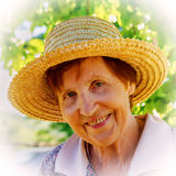 Portrait of a smiling woman in a straw hat.