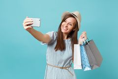 Portrait smiling woman in summer dress, straw hat holding packages bags with purchases after shopping doing selfie shot. Portrait smiling woman in summer dress stock photography